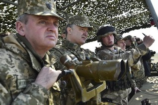 "Ukraine says separatists step up attacks, Poroshenko warns of ""threat of war"""