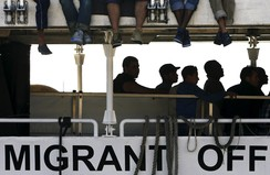 Migrants wait to disembark from the Migrant Offshore Aid Station (MOAS) ship MV Phoenix in the Sicilian harbour of Messina