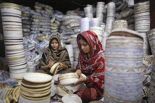 Low pay, few jobs cost women in poor countries $9 trillion a year: charity