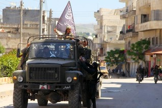 Islamist fighters seize Syria's Jisr al-Shughour, army says redeploys