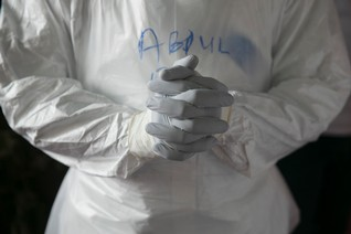A Sierra Leonean doctor practises wearing protective clothing in the Ebola Training Academy in Freetown, Sierra Leone, December 16, 2014