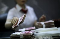 China probes Uighur mayor of restive Xinjiang city for graft