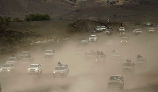 Vehicles carrying followers of the Shi'ite Houthi movement drive on a road leading to the movement's camp in southern Sanaa