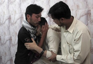 Pakistani gunmen kill three in attack blamed on Islamist groups