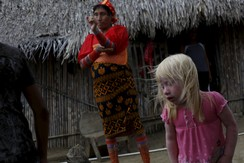 "Iveily Morales, 3, who is part of the albino or ""Children of the Moon"" group in the Guna Yala indigenous community, stands next to her mother at their house on Ustupu Island in the Guna Yala region, Panama April 24, 2015"