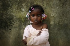 Abiba, 3, poses for a picture a day ahead of the International Day of the African Child, in Abidjan, Ivory Coast
