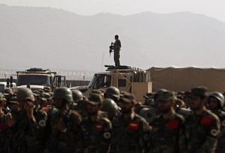 Rivals row over top Afghan defence posts as Taliban goes on attack