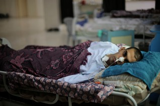 A Palestinian patient lies on a bed at a branch of El-Wafa rehabilitation hospital, in Gaza City August 28, 2014
