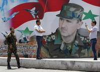 Once on the edge of defeat, Syria's Assad runs again for president