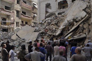 Syrian air raids kill dozens of civilians in north - monitoring group