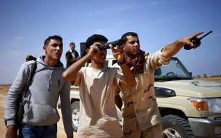 Islamic State fighters take on Libya's rival government forces