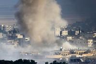 Air strikes hit Kobani as Kurdish peshmerga prepare to enter