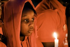 A girl holds a candle during a vigil for the girls who were abducted from a secondary school in Chibok, on the anniversary of their abduction in Abuja