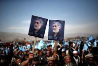 Afghan presidential hopeful Abdullah supporters over fraud