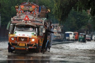 Deadly flash floods in Pakistan damage roads and crops