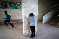 Children play hide-and-seek during lunch break at the Hand in Hand Arab Jewish bilingual school in Jerusalem