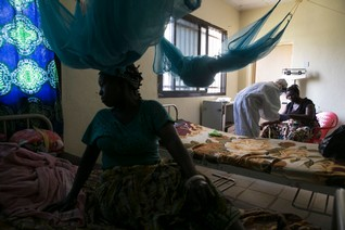 Health worker attends to a patient at the maternity ward in the government hospital in Koidu, Kono district in eastern Sierra Leone
