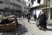 Syria says Red Crescent aid workers wounded in Homs
