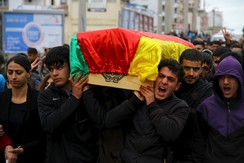 Mourners carry coffin of Yakup Sinbag a civilian who was killed during the clashes between Turkish security forces and Kurdish militants, in Silvan in the southeastern Diyarbakir province, Turkey