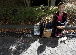 Japan's tiny refugee community urges Tokyo to open doors wider