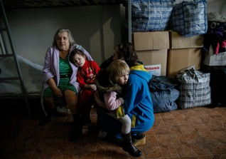 Refugees, who left their homes because of the fighting in eastern Ukraine, are seen in a volunteer centre in Slaviansk