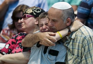 Family members mourn in West Bank Jewish settlement