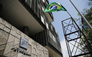 Petrobras takes $17 bln charge in wake of scandal, promises 'normality'