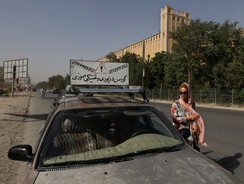 Kanaz, 21, gets out of a car after a practical driving lesson in Kabul August 14, 2014