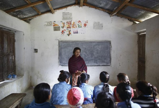 Rupa Chand Shah, 32, a school teacher who does not support the practice of Chaupadi, teaches an awareness class at Shree Devi Mando School in the hills of Legudsen village in Achham District in western Nepal February 16, 2014. REUTERS/Navesh Chitrakar