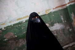 Gisele Marie, a Muslim woman and professional heavy metal musician, smokes a cigarette before a fund raising concert for Syrian refugees in Brazil, in Rio de Janeiro