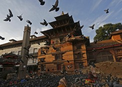 A Nepal army soldier stands guard near a damaged temple at Bashantapur Durbar Square, after the earthquake in Kathmandu
