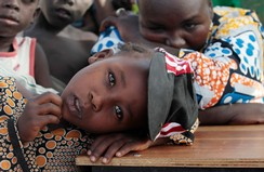 Girl displaced as a result of Boko Haram attack in the northeast region of Nigeria, rests her head on a desk at Maikohi secondary school IDP camp in Yola, Adamawa State
