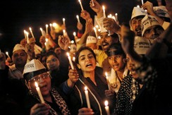 Supporters of AAP shout slogans as they participate in a candle light vigil during a protest against the rape of a female passenger, in New Delhi