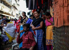 Female sex workers (FSWs) watch a street performance to mark World AIDS Day in Kamathipura, Mumbai's red light district, December 1, 2014