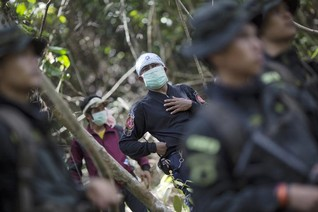 Bodies from Thai mass grave show no initial signs of violent death -police