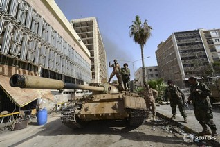 Amnesty calls for UN sanctions, war crimes probe in Libya