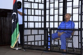 Libyan court sentences Gaddafi son Saif, 8 other ex-officials to death