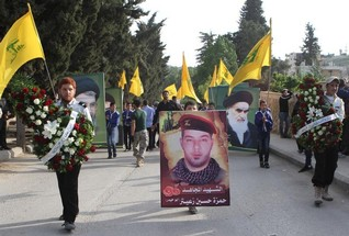 Hezbollah fighters attack Syrian al Qaeda gathering along border