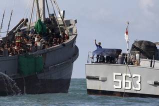 Myanmar escorting boat crammed with migrants to 'safe' area