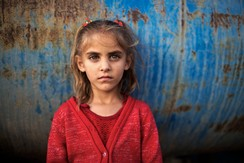 Five-year-old Bedouin girl Tuqa Abu Alqean poses for a portrait in the 'unrecognised' village of Um Al-Hiram in southern Israel's Negev desert, October 16, 2014