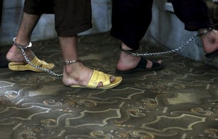 Afghan court commutes death sentences in woman's mob killing