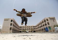 A boy skips at a school in Yemen's capital Sanaa sheltering people after the conflict forced them to flee their areas from the Houthi-controled northern province of Saada