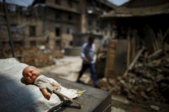 A doll lies near the debris of collapsed houses after the April 25 earthquake at Khokana in Lalitpur May 11, 2015.