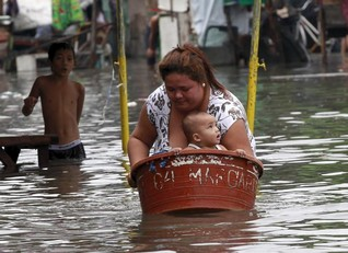 Tropical storm shuts Manila schools, floods northern Philippine towns