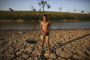U.N. talks of tough global climate targets, vague on national action