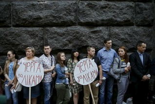 Activists of the All-Ukrainian Network of People Living With HIV/AIDS, a non-governmental group, take part in a rally in front of the Ukrainian cabinet of ministers building in Kiev