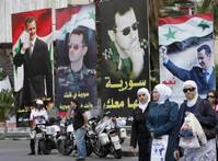 Syrians vote in wartime election set to extend Assad's rule