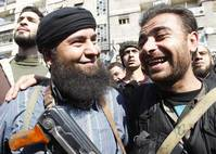 Syria's warring parties share ire over photos of local truce