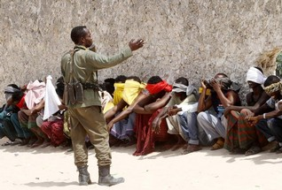 Somali Islamist with $3 mln U.S. bounty on head surrenders - Somali govt source