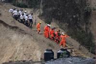 Dead families found huddled together in Guatemala mudslide